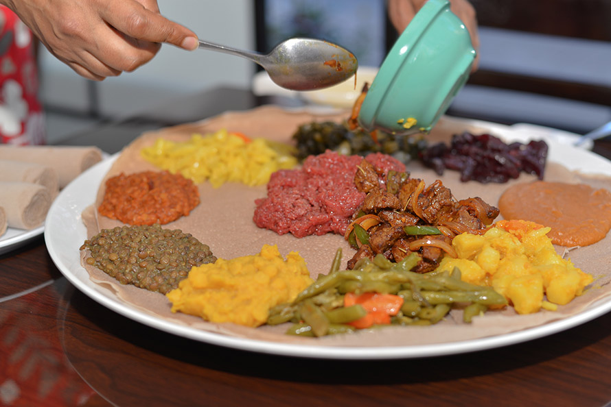 Benyam-Veggie-Sampler-with-Awaze-Tibs-and-Kitfo ethiopian restaurant Harlem NYC